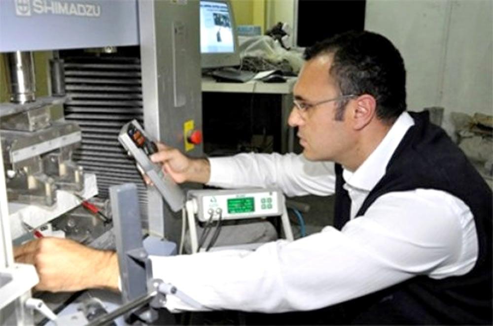 Dr. Sahmaran tests the performance of healed ECC specimen under mechanical loading.