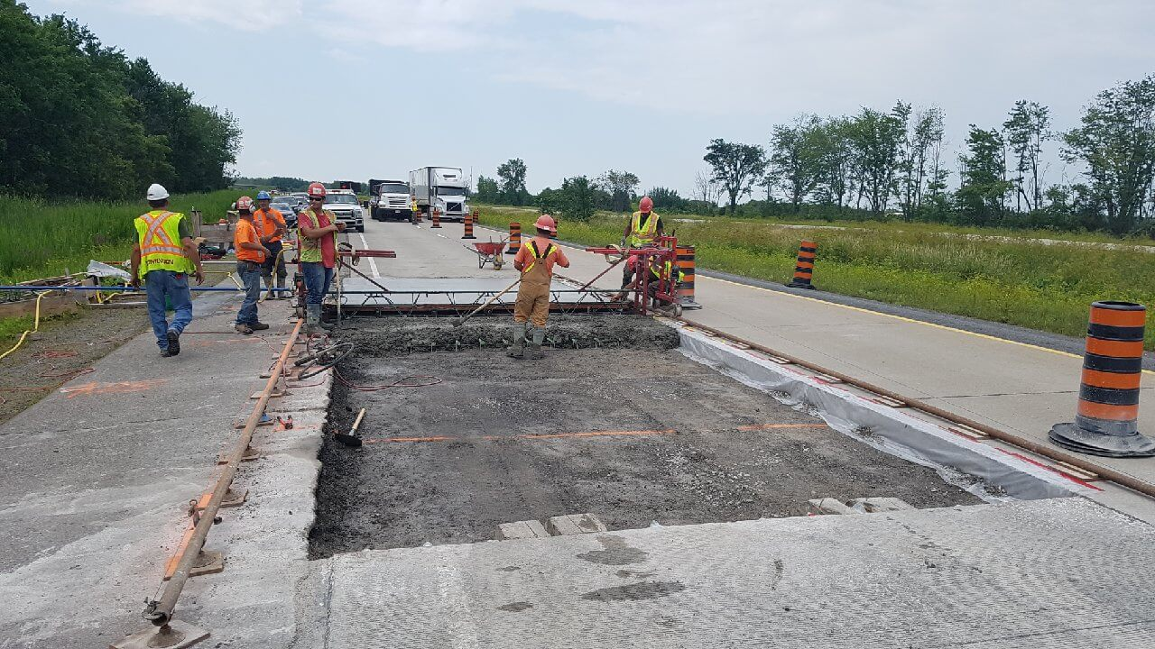 Placing concrete on highway construction project