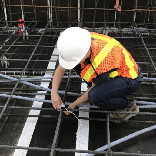 Construction worker installing a Giatec SmartRock sensor